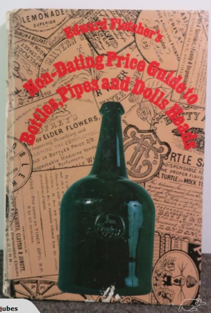 Book cover showing green glass bottle