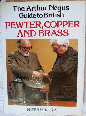 Book cover showing two men examining object